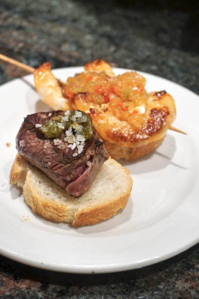 white plate topped with two pintxos